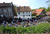 The peloton races through the Limburg village of Elsloo, about 10-kilometres into the day...