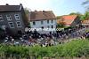 The peloton races through the Limburg village of Elsloo, about 10-kilometres into the day...