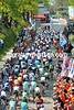 Luxembourg fans are in evidence as the peloton crosses the Cauberg summit for the first of three passages...