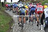 The Kwaremont is slippery today, causing problems for the weaker riders on the climb...