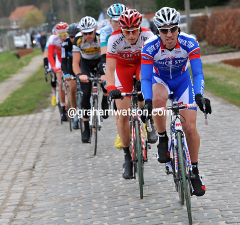 Quick-Step leads the chase on the same cobbles - this team needs a result today..!