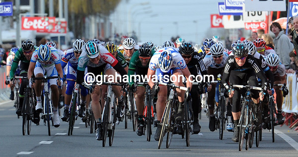 The sprint is on into Kuurne - who's that little guy in black leading the way..?