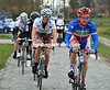 Thomas Voeckler is in there as well - he leads the way on to the cobbles at Anzegem...