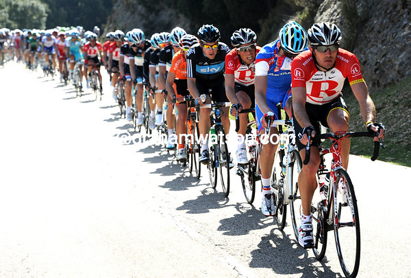 Radio Shack takes to the front of the peloton in pursuit, led by Yaroslav Popovych...