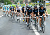 Team Sky bend to the task of chasing along the windswept valley towards Faverges...