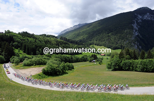 The peloton is still more or less intact as it climbs the Col de St Jean-de-Sixt after 55-kilometres...