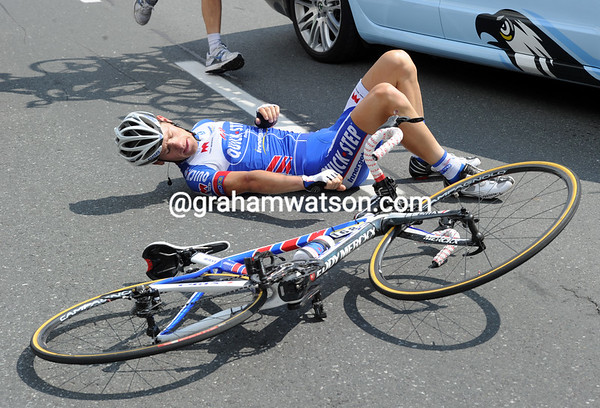 Kevin Seeldraeyers has fallen in the feed-zone, but he's not badly hurt...