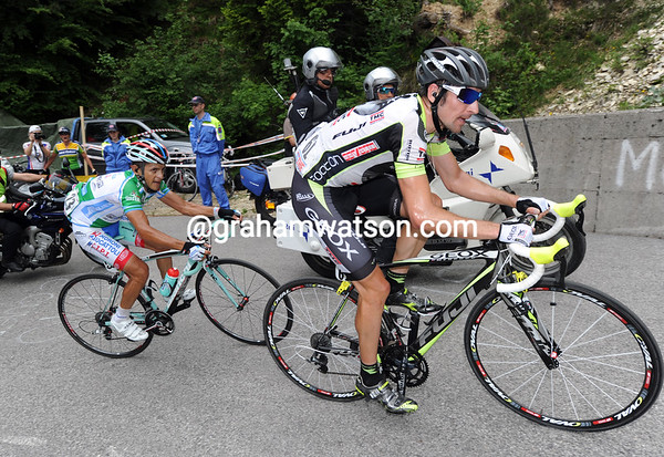 Denis Menchov is not far back, and he has Jose Rujano with him about 1/3rd of the way up the Zoncolan...