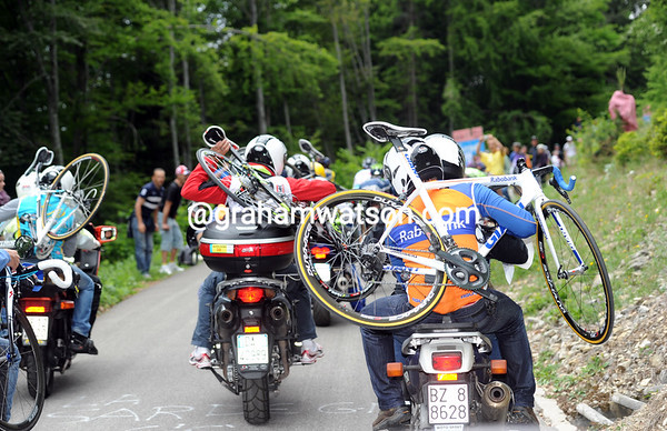 The team mechanics trail the action, waiting to move up or down with their leading riders...