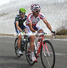 Joachim Rodriguez and David Arroyo have ridden away from Contador's group, but they'll be caught at the foot of the next climb...