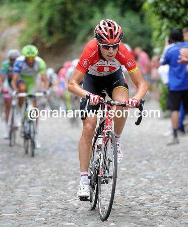 Phillip Deignan has attacked on the pebbled climb into Bergamo Alta...