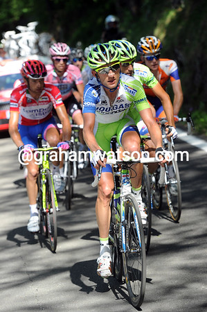 Sylvester Szmyd leads the Maglia Rosa group - but there are barely a dozen riders still in it...
