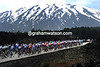 White snows and black lava frame the peloton as it approaches the first summit of Mt Etna...