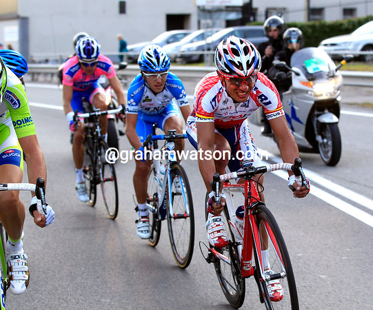 Five men are chasing Zaugg, led primarily by Rodriguez, Basso and Martin...