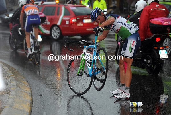 It's wet, it's slippery - and a few riders like Lagutin have fallen on a roundabout...
