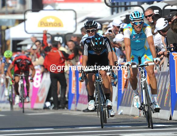 Roman Kreuziger takes fourth place 24-seconds later, ahead of Rigoberto Uran..