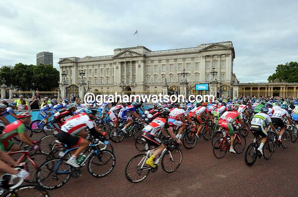 The peloton rolls past Buckingham Palace at the start of a 140-kilometre day...