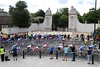 The peloton is seven minutes down as it passes the side entrance to Hampton Court Palace...