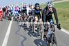 The chasing peloton is led by Daniel Lloyd...