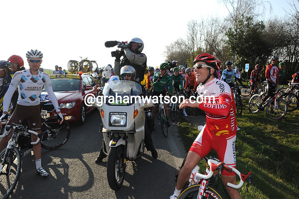Gallopin and Bouet entertain the peloton after being stopped by a closed railway crossing - the race will re-start with them free to escape again...
