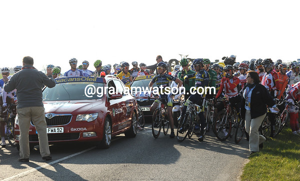 45-seconds and counting - the peloton has to wait before it can re-commence racing...