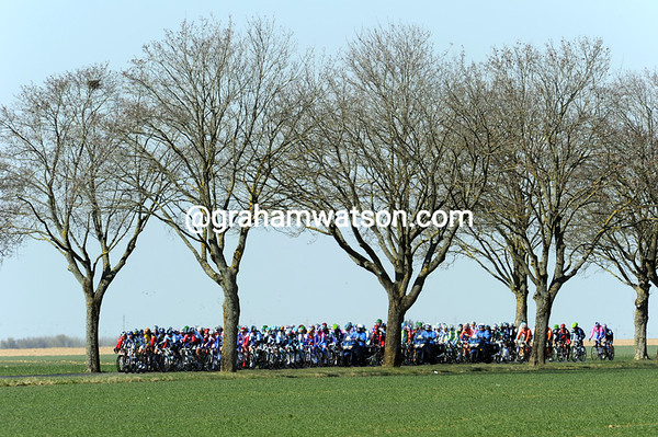 It's cold enough to ensure the peloton is packed tightly as it crosses an exposed plateau...