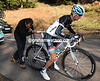 Frank Schleck gets a push after a wheel change - he doesn't look too comfortable does he..?