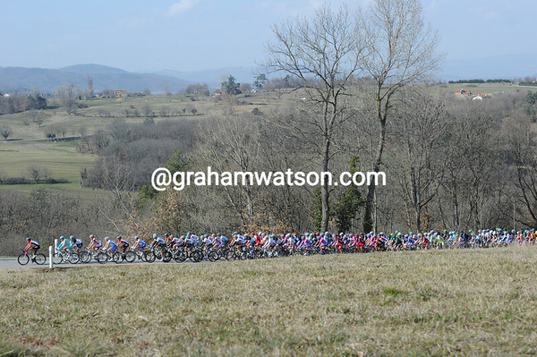 The peloton is about four minutes back and chasing quietly...