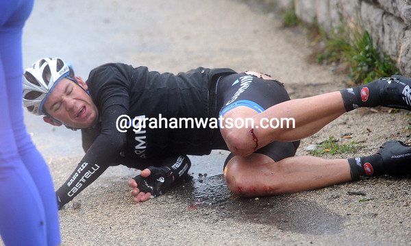 It's getting wet and slippery now - Martin Maaskant crashes heavily on the descent from Gourdon...