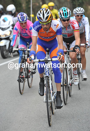 Ten Dam puts his head down ahead of the other five escapers - they gain a few minutes before the peloton reacts...