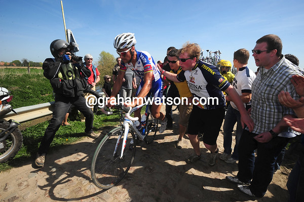 Boonen has gone down again, this time on the cobbles before Orchies...