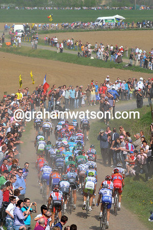 What's left of the peloton crosses the cobbles at Orchies, 45-seconds down on a new developing escape of seventeen men...