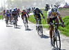 Lars Bak leads the 17-man escape towards the next cobbles near Ennevlin...