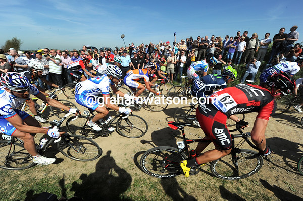 The peloton arrives at another section almost two minutes behind the escape...