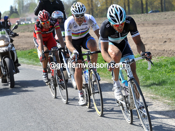 Suddenly, Cancellara has attacked, but he has Hushovd and Ballan with him...