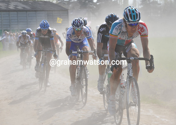 Jurgen Roelandts leads the escape past the windmill at Vertain - they posess an uncertain fate with the Cancellara-Hushovd duel so finely balanced...