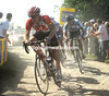Gregory Rast takes the ecape on to the cobbles near Cysoing - Cancellara and Hushovd have eased up in their pursuit...