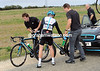 Chris Sutton makes a bike change after the chaos following Verschoor's fall...