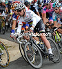 Cavendish takes a corner in his stride in his first race as World Champion...