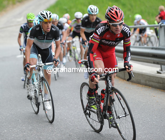 Cadel Evans makes an acceleration as the peloton starts the climb to Leysin...