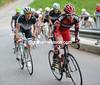 Cadel Evans makes an acceleration as the peloton starts the climb to Leysin...