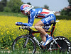 Taylor Phinney looks colourful against the mustard seed flowers...