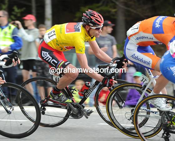Evans looks quite untroubled by the action as he descends towards the Lake of Leman at the heart of the peloton...