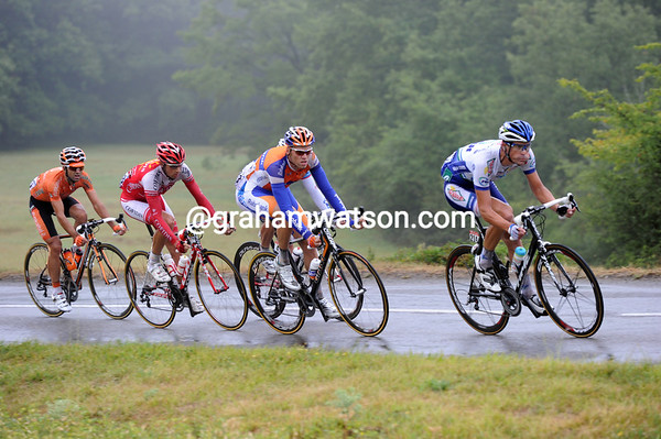 Jimmy Engoulvent is helping push the gap up to five minutes on roads too wet for the peloton to chase on...