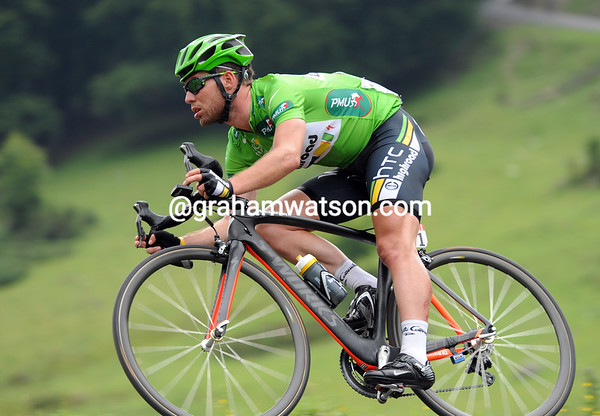 Green on green - Mark Cavendish descends the first Col in his Green jersey...