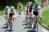 David Millar is leading a 20-man escape towards the Col de Portet d'Aspet...