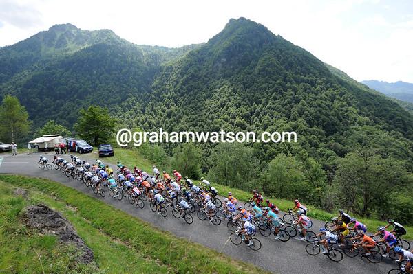 The peloton climbs the pretty Col de Agnes, still five-minutes down on the escape...