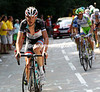Frank Schleck makes his first move of the day, but then eases up...