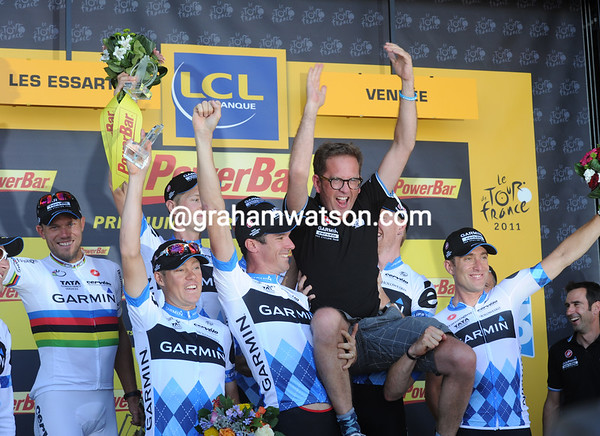 Garmin-Cervelo celebrate their win with team manager, Jonathan Vaughters hoisted high...