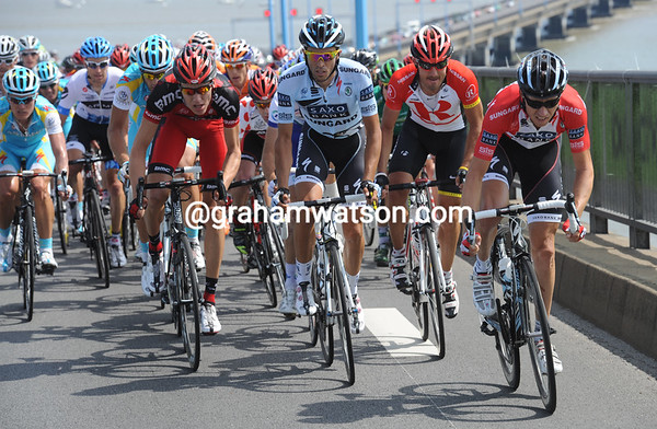 Alberto Contador is right at the front of the peloton as the Tour climbs the windswept bridge...